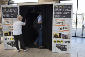 Commuters enter Ticket to Ride pod